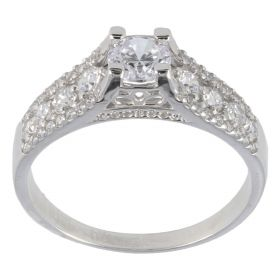 Solitaire ring decorated with white gold and zircons