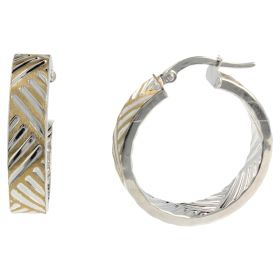 Round earrings in yellow and white gold