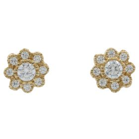 Flower earrings in yellow gold with white zircons