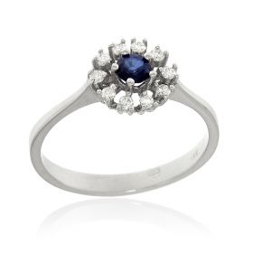 White gold ring with diamonds and sapphire