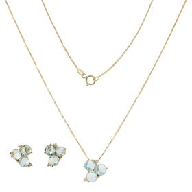 Yellow gold Trilogy jewelry set with blue topaz