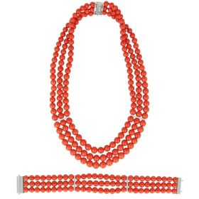 Set in red coral, 18kt white gold and diamonds