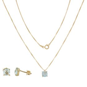 Light yellow gold set with blue topazes