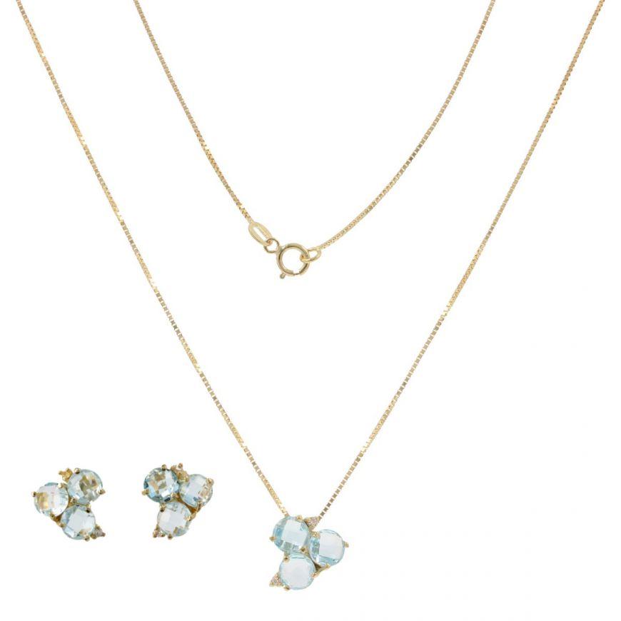 Yellow gold Trilogy jewelry set with blue topaz | Gioiello Italiano